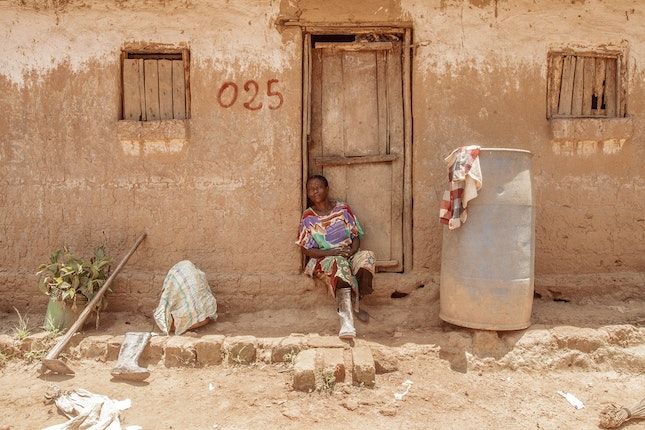 A woman sitting in a doorway