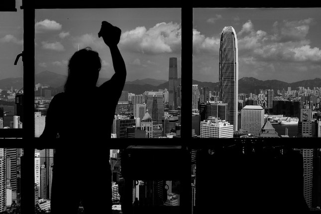 A woman at the window of a tall building