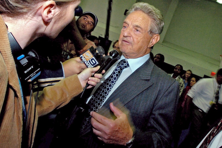 George Soros talking to reporters