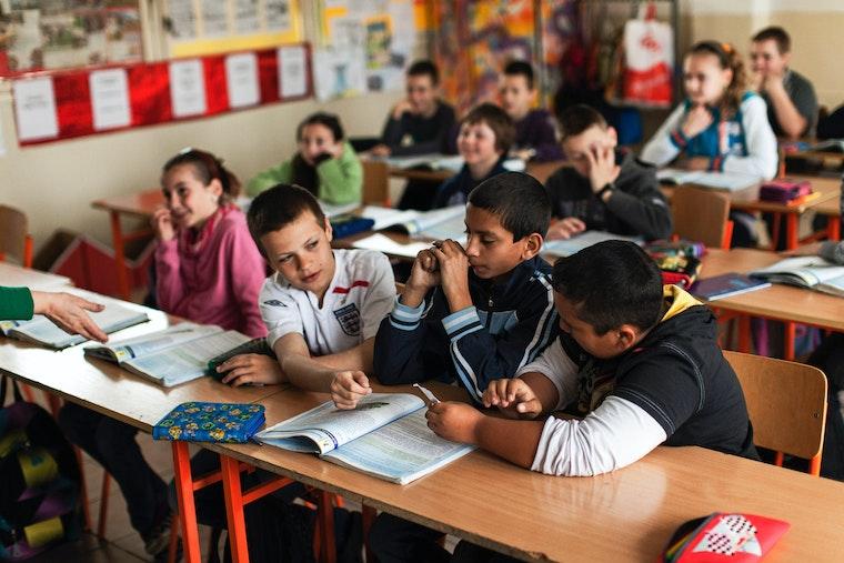 Children at desks in a classroom