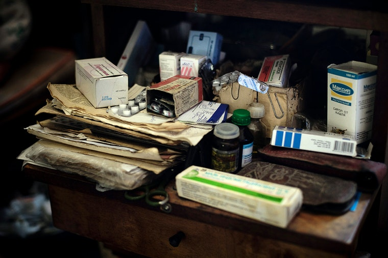 Medicines and papers on a desk
