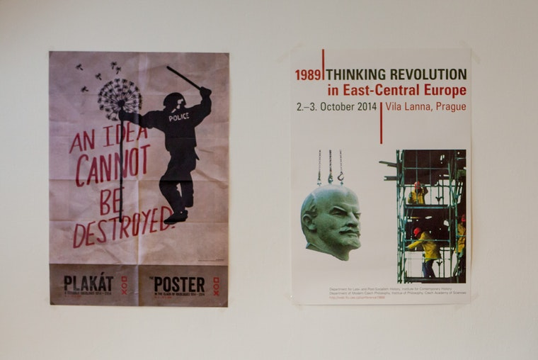 Art exhibition posters on a wall