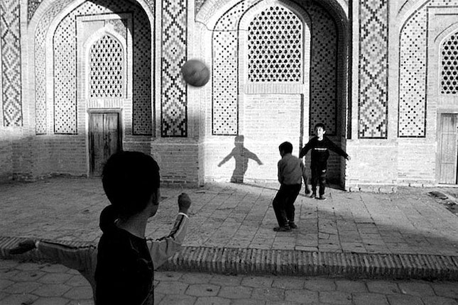 Young children playing with a ball.