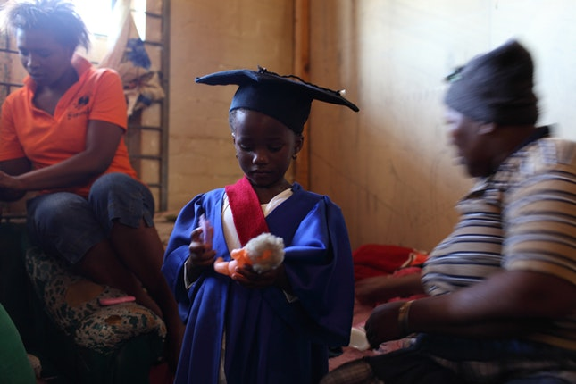 Young child preparing preschool graduation