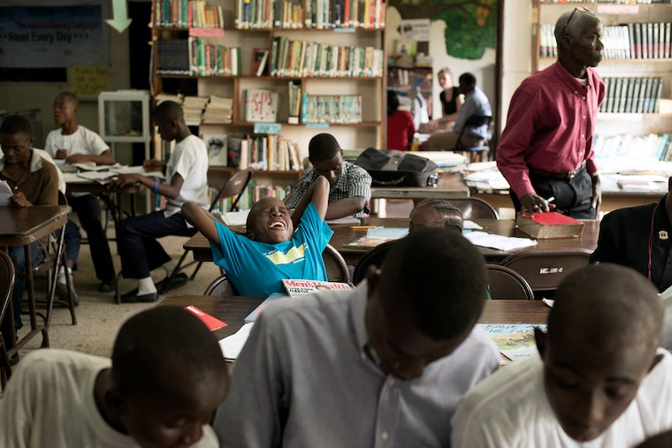 Students studying in a library in Liberia.