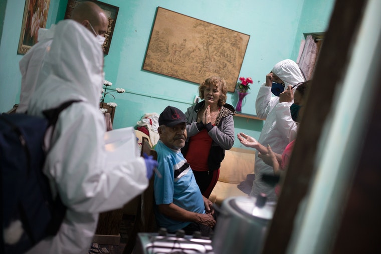 Nurses examine a man in his home