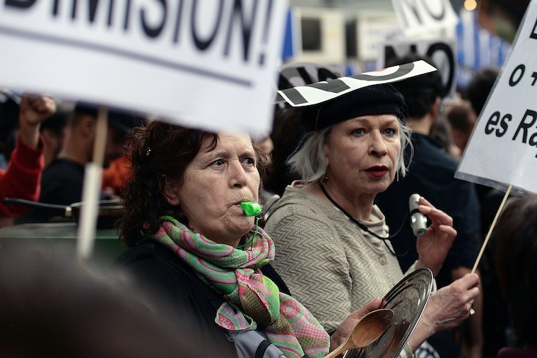 Demonstrators with whistles in a crowd