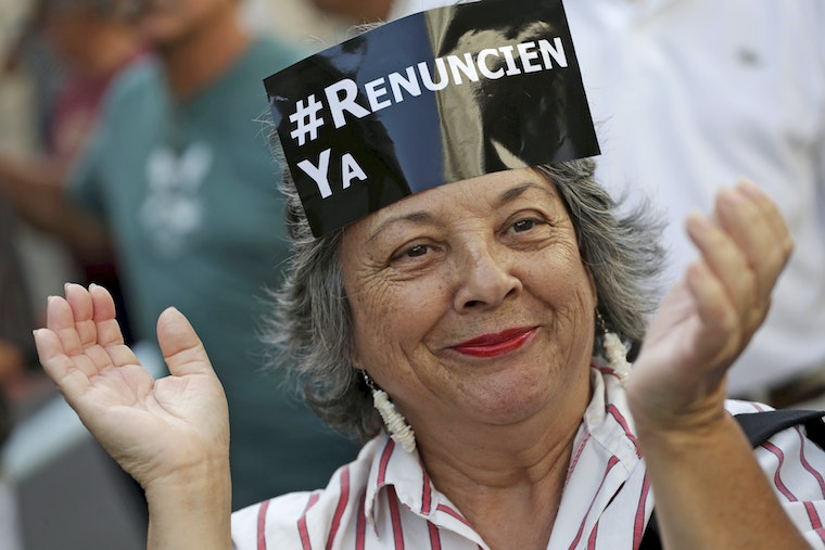 A woman with a sign on her forehead