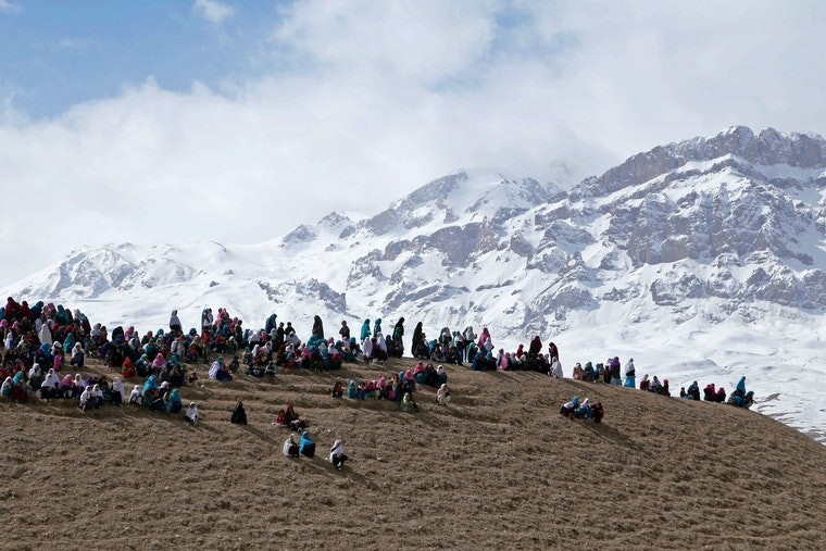 People gathered on a mountain ridge