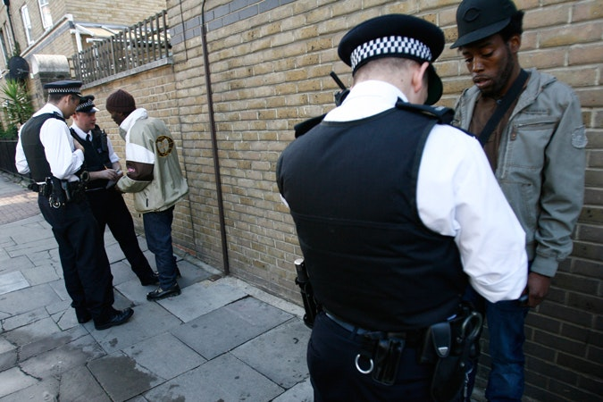 Two police officers stop two men