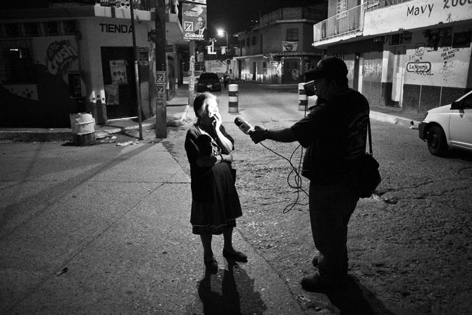 A journalist interviewing a woman