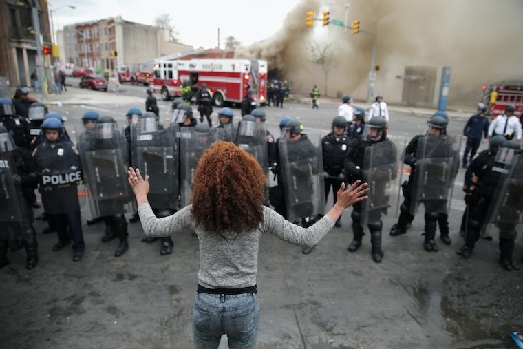 Woman in front of police