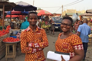 Two bankers in a market in Ghana