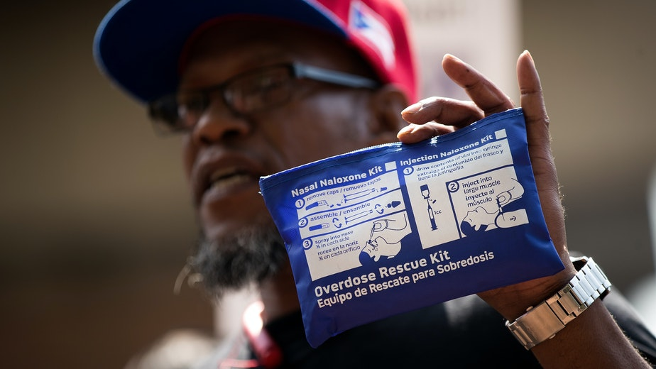 A man holds up an overdose kit during a protest denouncing New York City's response to the overdose crisis on August 10, 2017.