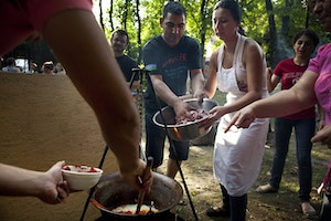 Participants in the Barvalipe Roma Pride Summer Camp add spices to a pot