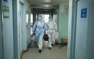 Two doctors walking in a hallway