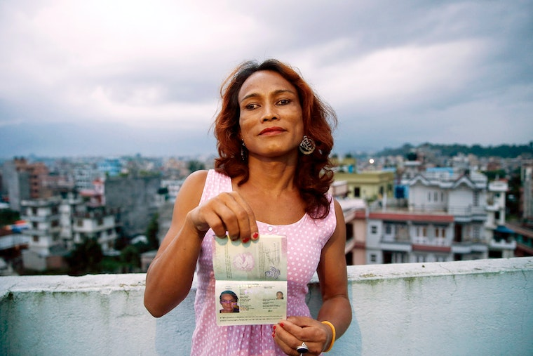 A woman holding her passport
