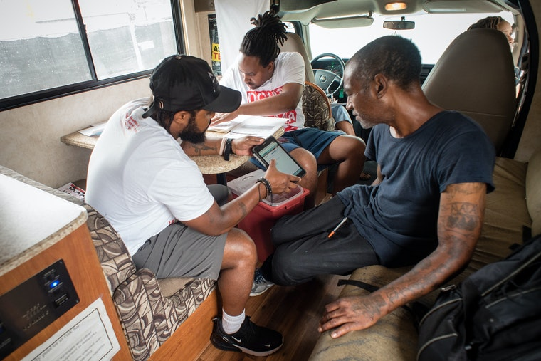 Three people in a mobile clinic