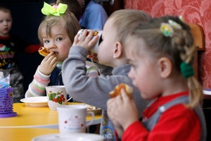 Children eating and drinking