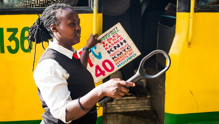 A woman working for a bus company