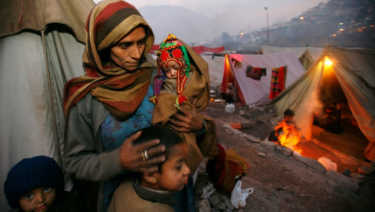 A woman with several children among tents