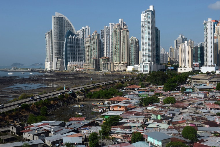 Panama City's skyline behind multiple makeshift homes.