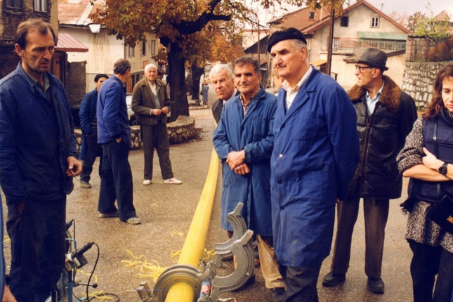 A team of workers cutting pipes