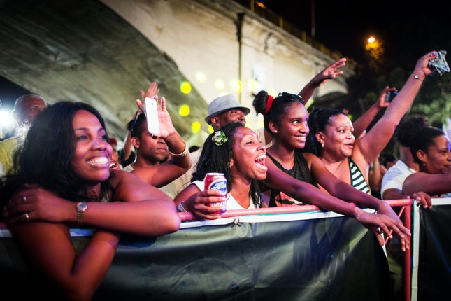 Group of women cheering at a concert