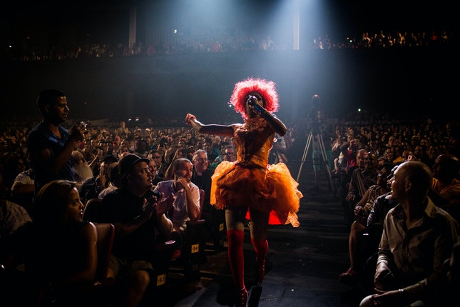 Performer singing in the aisle