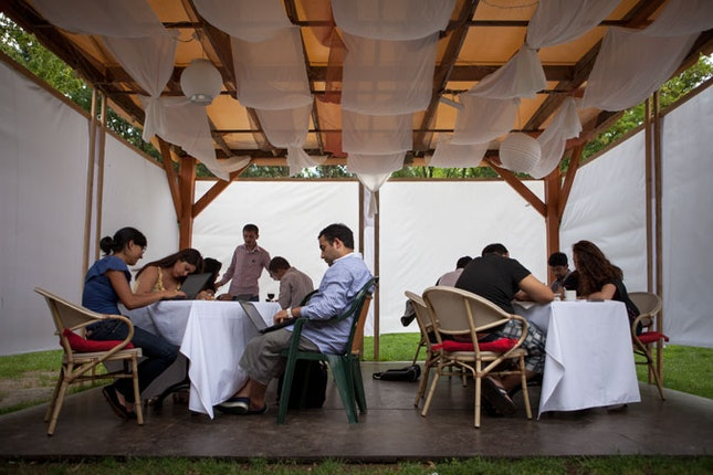 Barvalipe participants sitting at tables.