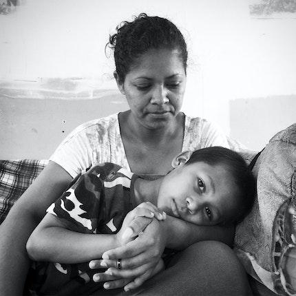 Woman holds boy
