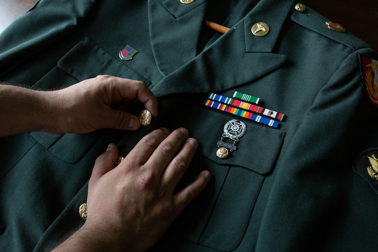 Hands on a military uniform