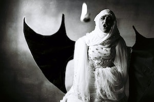 A woman wearing a wedding dress and dragon wings