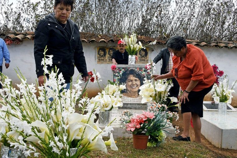 People and flowers in a cemetery