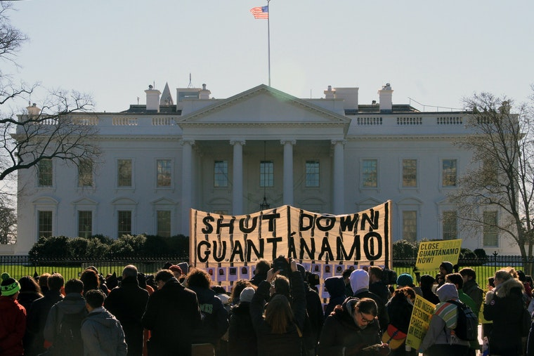 """A large banner in front of the White House that says """"Shut Down Guantanamo"""""""