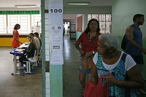 People in a polling station