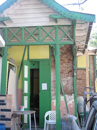 House with green doors and trim