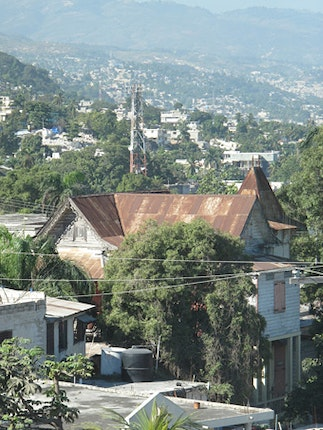 View of rooftops among the hills