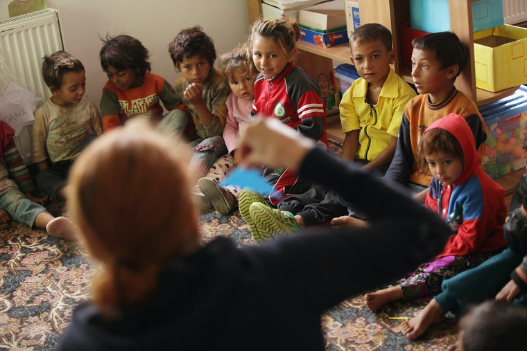 Preschool children sitting in a circle