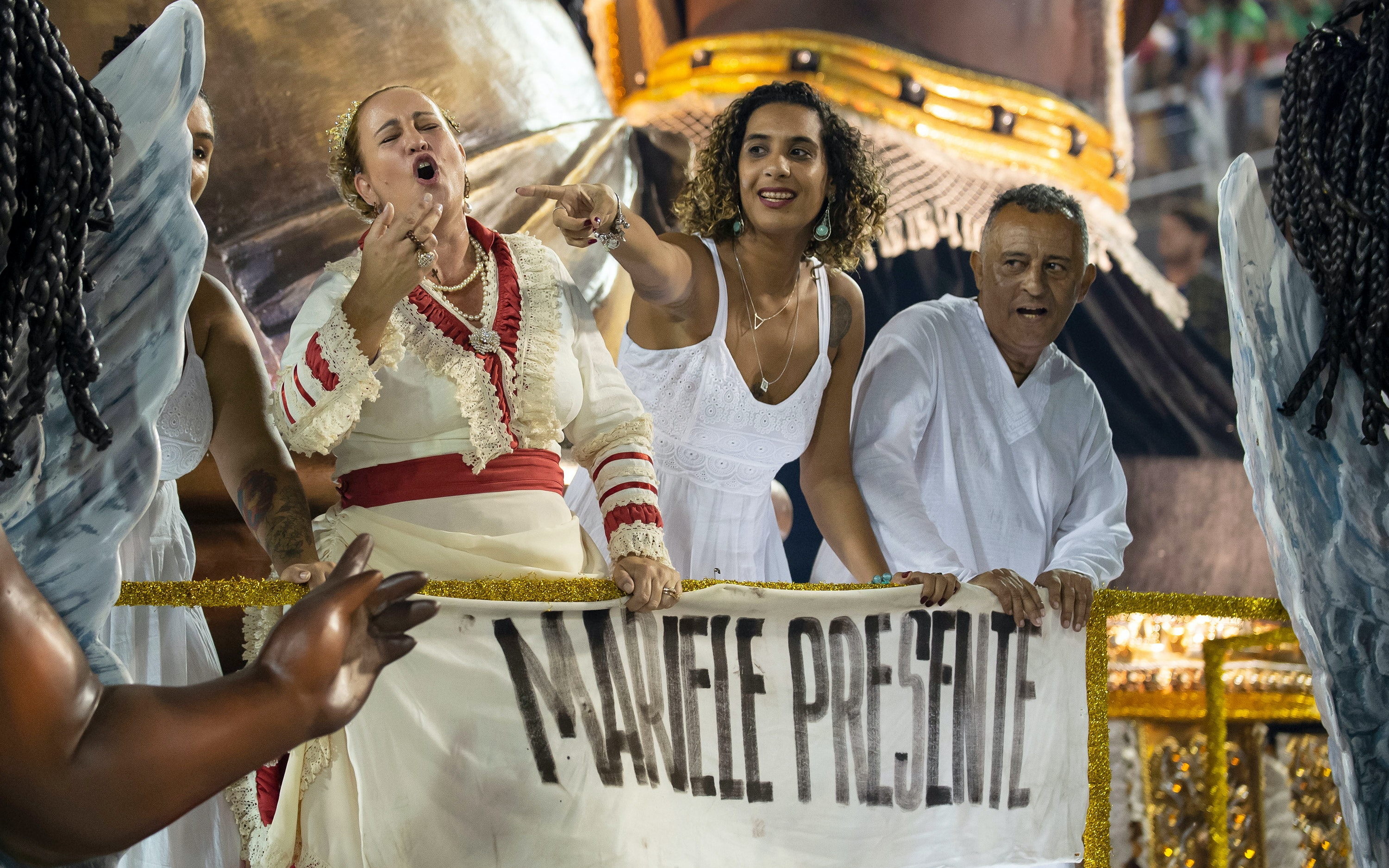 Anielle Franco and others on a float in a parade