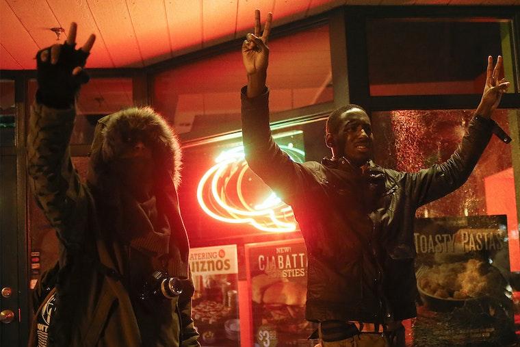 Men hold hands up