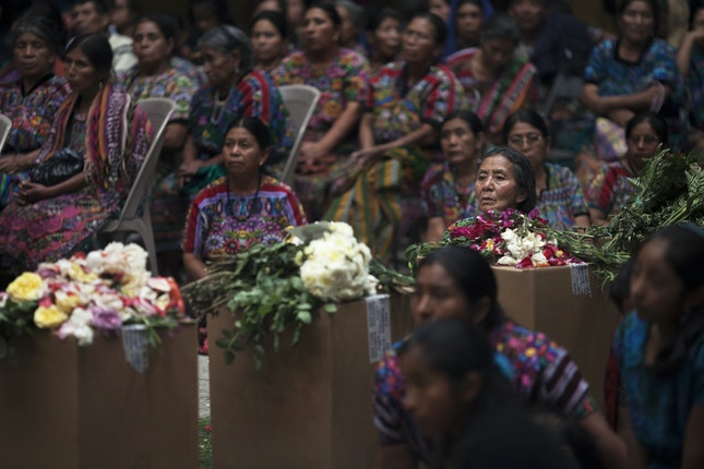 Large group of women with boxed remains
