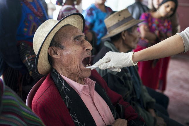 A man having his mouth swabbed