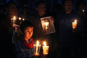Mourners holding candles