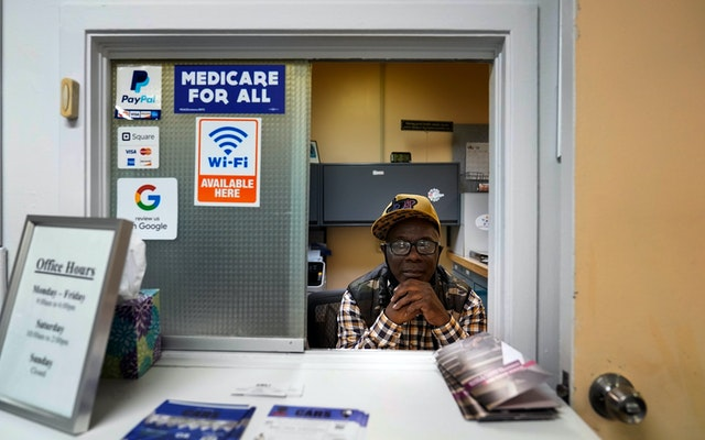 A man at a medical clinic window