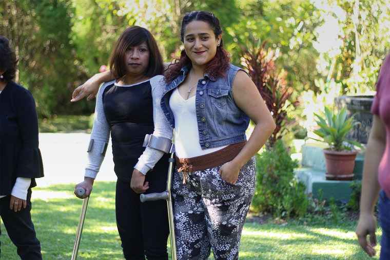 Two women standing outdoors