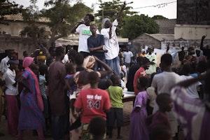 Crowd watches men rap