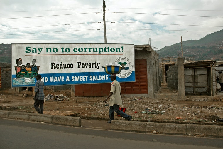 "A billboard that reads, ""Say no to corruption! Reduce poverty"""
