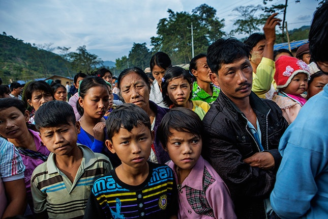 Children and adults waiting for food stamps