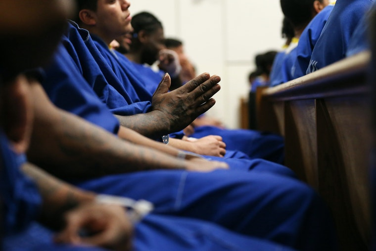 A group of male inmates pray